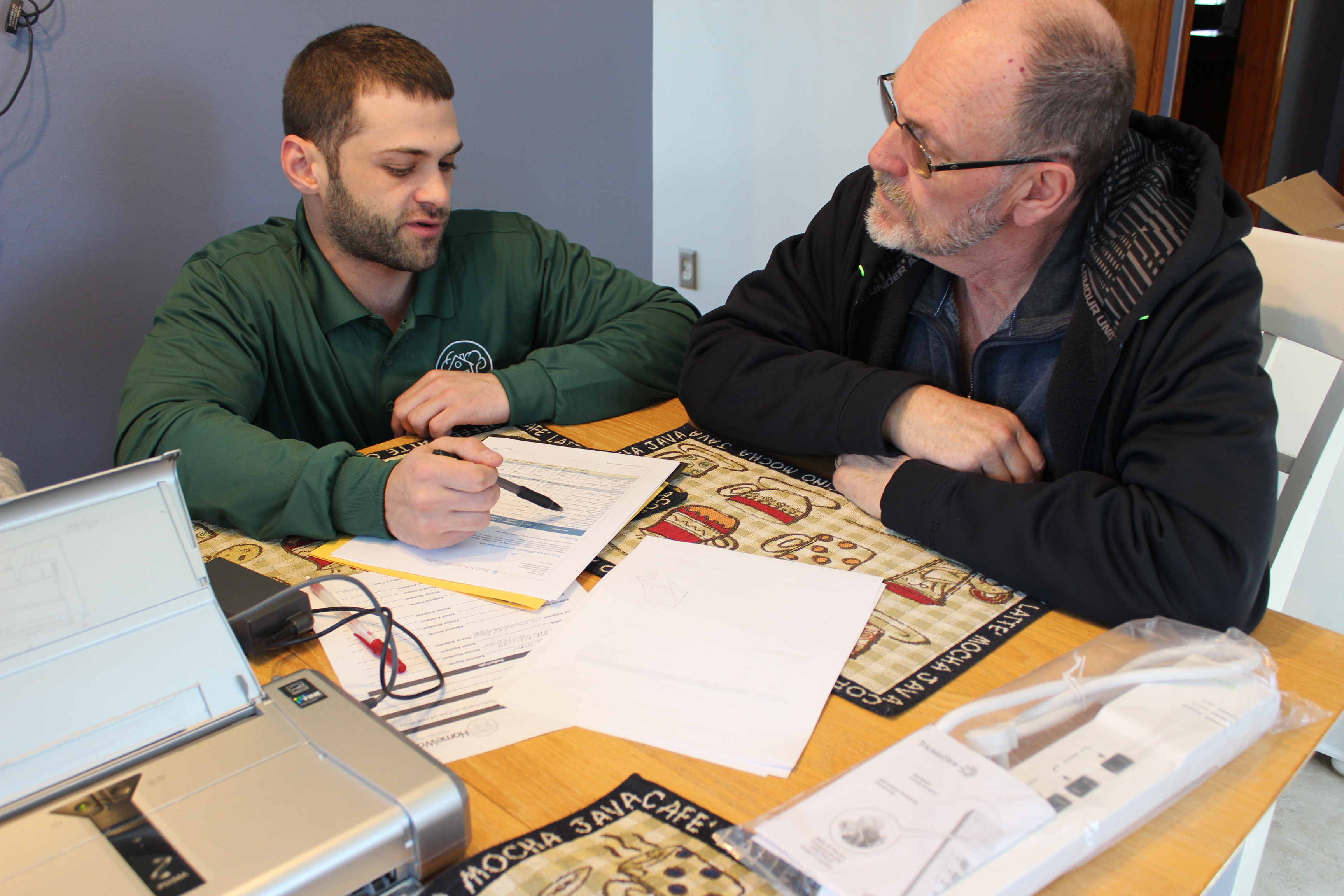 HWE reviewing a no-cost energy report with customer